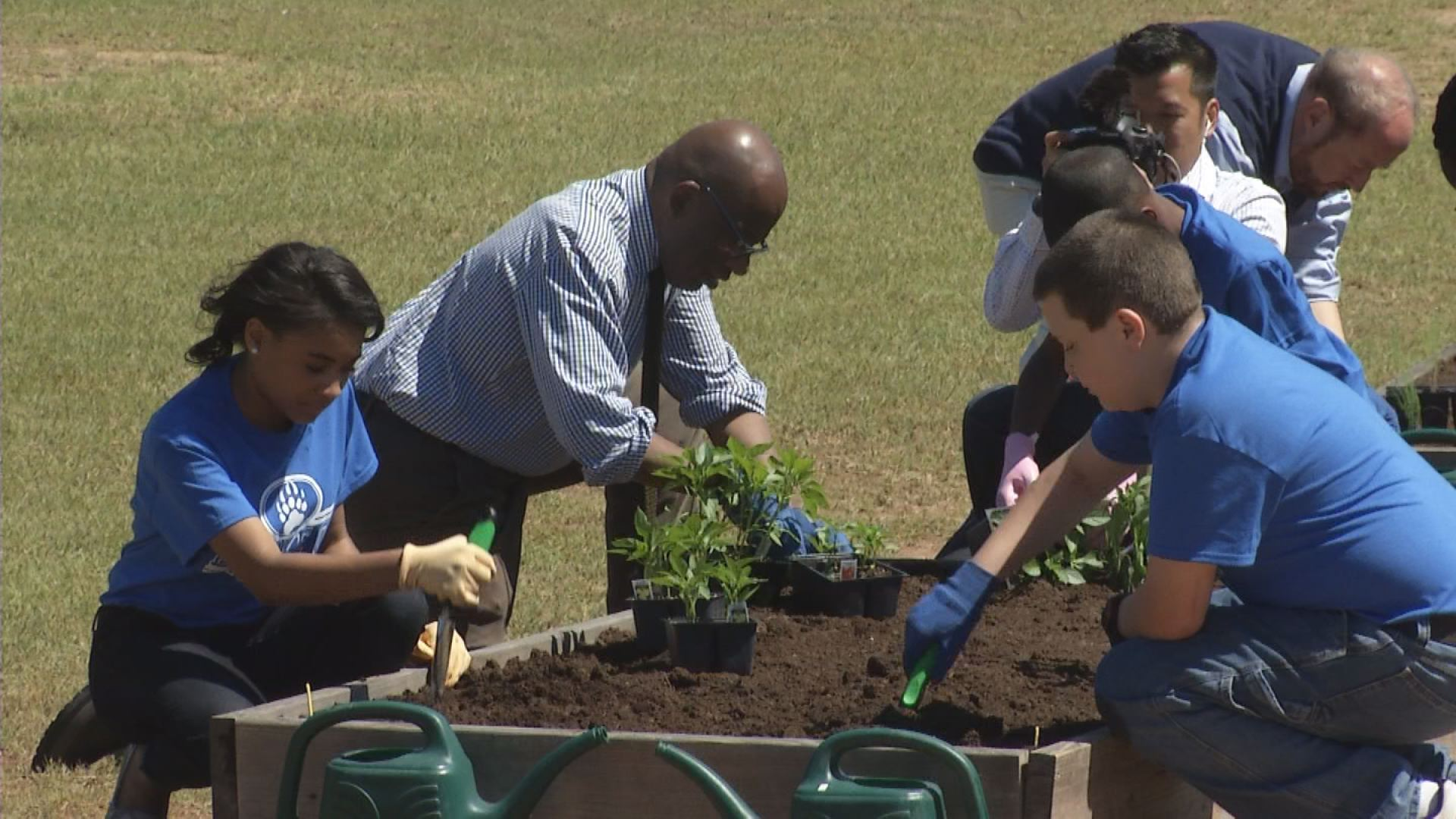 Al Roker helps plant cucumbers and peppers at the rural school's garden.