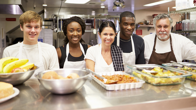 Portrait Of Kitchen Staff In Homeless Shelter_338783