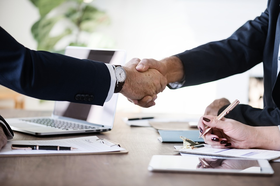 Making a deal handshake generic image_1526560224888.jpg.jpg