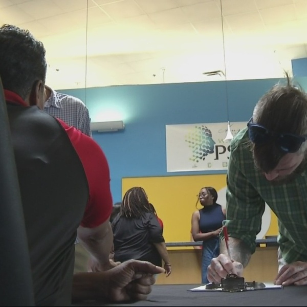 Hundreds show up for job fair at Sitel